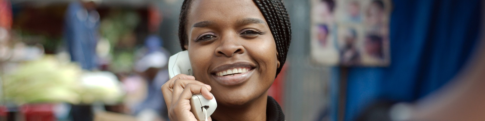 African or black American woman calling on IP telephone in Alexandra township
