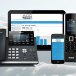 ACC Telecom's hosted cloud phone system software shown on a tablet and smartphone accompanied by two IP phones.
