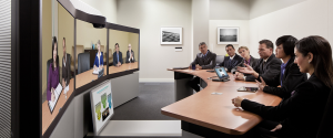 video conferencing in conference room with large screens
